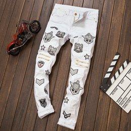 Wholesale Hot New fashion white men jeans ripped biker pants European and American Bar DJ style jeans male Badge Zipper trouser