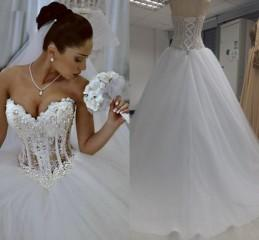 2016 Ball Gown Wedding Dresses Custom Made Sweetheart Corset See Through Floor Length Bridal Gowns Beaded Pearls Sequins Wedding Dresses