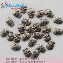 La orden mínima $ 10 libre shipping12 * 2-sku aleación de bronce 100pcs MetalStuds Nail Art cráneo de 16 mm, el teléfono celular del Rhinestone de acrílico Sticker desde órdenes de uñas acrílicas proveedores