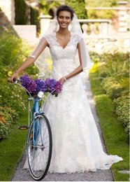 Wholesale Custom Made NEW Cap sleeves add coverage while illusion lace back adds allure Style T3299 Wedding Dresses