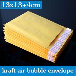 Descuento burbuja de papel kraft 100PCS 13x13 + 4cm color amarillo / Kraft Paper Bubble Envelope / envases de maletín impresión wthout