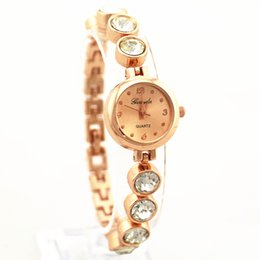 Wholesale big crystal deco metal belt gold plate alloy round case gold dial gerryda fashion woman lady bracelet style quartz watches