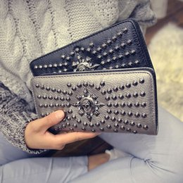 Wholesale 2016 New European Fashion Handbags Personality Ms Long Wallet Nail Rivet Skull Hand Bag Women s Hot Sale Notecase