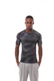 Wholesale New Athletic Slim Fit Pro Sport Men s short Sleeve T shirts Muscle Elasticity Running Biking Climbing gym Print short sleeves T shirt