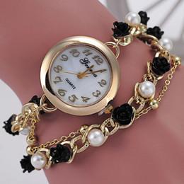 Montres de gros perle en Ligne-Genève montre perle noire fleur ornement entre bracelet montre dames mode quartz montre La vente en gros de l'usine