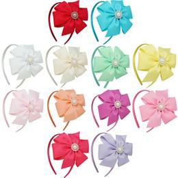 12 couleurs Bows Cheveux Avec Perle Rhienstone Fleur Chapeaux Ruban solide Accessoires Pinwheel Bow Band Cheveux Filles Cheveux 24 Pcs / lot gros solid pearl for sale à partir de perle solide fournisseurs