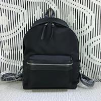 The latest high quality canvas bag Both men and women backpack 3 sizes Personality graffiti pattern black leisure bag