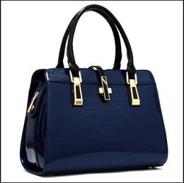The new Europe and the United States 2016 lady crocodile grain paint cross shaped handbag single shoulder bag
