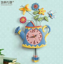Wholesale Classic living room wall clock mute creative art vases resin kettle bell swing spring wall clock