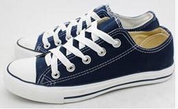 Altos tops hombres 45 en venta-Clásicas de alta calidad Bajo-Top de la lona calzados informales de la zapatilla de deporte de los hombres / los zapatos de lona tamaño EU35-45 de las mujeres