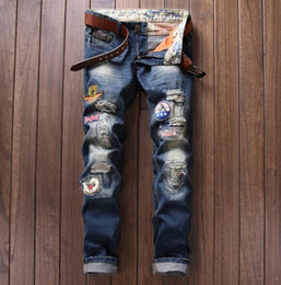 Wholesale 2016 Trash Distressed patches Biker Cargo with embroidery Hero stretch Demin jeans TOP Hiphop Cropped Jeans with Extreme ripped Straight