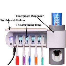 Wholesale 2016 New Kitchen UV Light Toothbrush Sterilizer Lamp Storage Automatic Toothpaste Dispense Toothbrush Holder Set