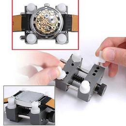 Relojes de los hombres titular en Línea-Venta al por mayor-Portátil relojera útil Mans Watch reparación herramienta Volver titular del caso Adjustable Remover abridor