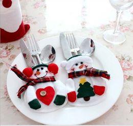 Wholesale Decoración de la mesa de Navidad Cuchillo Tenedor cucharadas Vajilla Sets regalos de Santa creativo Pequeño muñeco de nieve Inicio de la manga de Navidad Año Nuevo