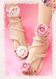 Handmade Pearl PU Flor Gladiador Planos Zapatos De Boda Campagus PU Nupcial Zapatos Sandalias De Las Mujeres De Verano Vacaciones Playa Sandalias Playa Zapatos 33--41 desde sandalias de perlas flores fabricantes