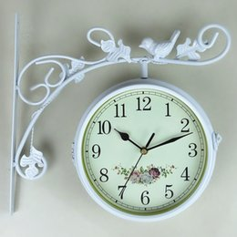 Wholesale Hand made metal home decoration on the wall double faced animated wrought iron double sided wall clock modern designed