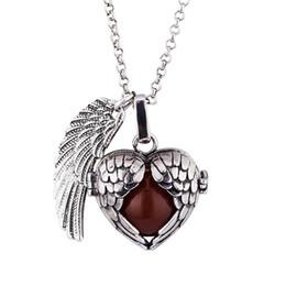 Acheter en ligne Anges ailes-Collier chaud de grossesse Collier pendentif boule d'harmonie Double aile d'argent d'or souhaitant cloche pendentif collier cadeaux Baby Angel caller