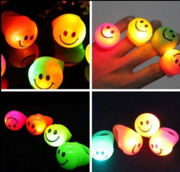 Cool LED Flashing Light Smile Finger Rings Blinking Party Soft Light Up Rave Glow Jelly Ring