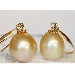 Elegant 10x12mm natural south seas gold pearl earrings 14k gold
