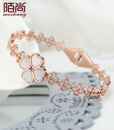 Mo is Korean fashion temperament hollow clover plated bracelet 18K rose gold color gold jewelry gift lover
