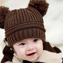 Descuento cute baby accesorios de fotografía bebé recién nacido lindo del bebé niños de la muchacha del muchacho de doble bolas de calentamiento casquillo hecho punto sombrero del invierno de los niños del bebé capó sombrero de apoyos de la fotografía