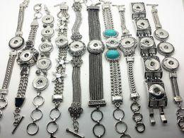 Wholesale La joyería intercambiable de la plata de la pulsera de cadena de la pulsera de cadena de la manera de las mujeres mezcló el botón apto del encanto del pedazo del broche de presión del jengibre de NOOSA m m