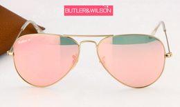 Gafas de sol de color rosa en venta-2017 nuevos hombres superiores de las mujeres de la manera metalan las gafas de sol cristalinas de la lente del vidrio del marco del oro del piloto azul del espejo en caso de 58m m