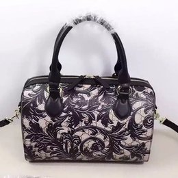 Wholesale Black latest storm flower tact package the original leather production the original high quality hardware high end quality concern handbag