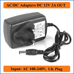 Wholesale 12V A UK Plug AC DC Adapter AC100 V Converter to DC2000mA Power Supply mm x mm for LED strip light mini TV ADSL