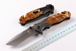 Wholesale Promotion Brown X50 Fast opening Tactical folding knife Grey Titaniun Blade Steel wood handle camping knife knives wtih Original paper box