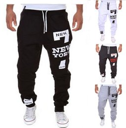 Wholesale Outdoor trousers hot selling men s loose fitting trousers letter printing buggy cool long wide sweatpants jogger wearing