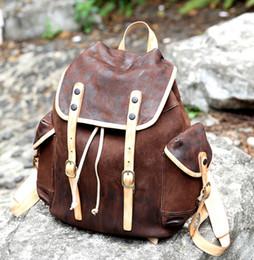 Vintage nouveau designer Hommes cuir véritable brun foncé Sacs à dos femmes sacs à bandoulière homme voyage organisateur sports sacs à main Sacs à main Garçons Filles à partir de hommes bruns sacs à dos fournisseurs