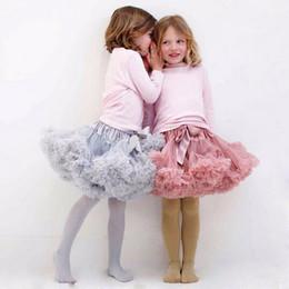 Descuento faldas para las muchachas de los niños Falda del tutú de los niños Los bebés del estilo de Corea faltan la falda linda de Tulle del bowknot El color plisado de la mezcla de la falda de la muchacha