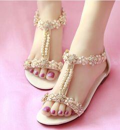 Sandalias de perlas flores en venta-Cristal flor perla plana Zapatos de Cowskin zapatos de boda de playa Sandalias nupcial Zapatos Sandalias Mujer Sandalias de playa de vacaciones de verano 34--40