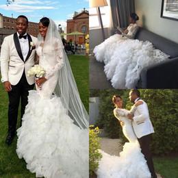 Luxury African 2019 Sheer Jewel Neck Wedding Dresses Long Sleeve Mermaid Bridal Gowns Cascading Ruffles Garden Wedding Dresses Country Style