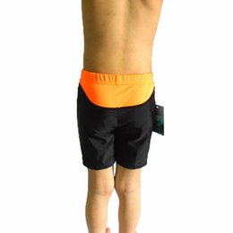 Wholesale Children swimming trunks professional quick drying cuhk children s game training swimming trunks Private label