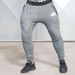 2016 al por mayor de la ingeniería Wholesale-2016 Medalla de oro nuevo gimnasio pantalones elásticos ocasionales, estirar los hombres del algodón de los pantalones Cuerpo de Ingenieros del basculador al por mayor de la ingeniería en oferta