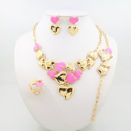 Wholesale 2016 new heart shaped jewelry set including necklaces bracelets rings earrings four exquisite alloy suit for pink sea blue red and pur