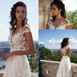 Vintage 2017 Summer Beach Wedding Dresses Cap Sleeves Retro Cheap Bridal Gowns A Line Illusion Neck Gorgeous Arabic Dubai Gowns
