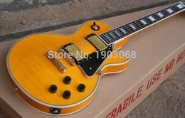 Wholesale price Custom LP DELUXE electric guitar with golden hardware AAA Carved figured maple top Appetite yellow color with hardcase
