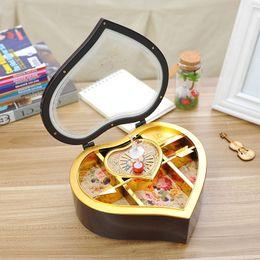 Wholesale Rotating girl heart music box Creative clockwork plastic music box Plastic desktop furnishing articles couple gifts