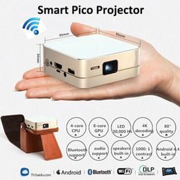 Acheter en ligne Quad lcd-Vente en gros-Hot, Quad core android 4.4 mini-conduit à la main de poche home theater vidéo jeu Miracast / Bluetooth lcd projecteur intégré dans la batterie