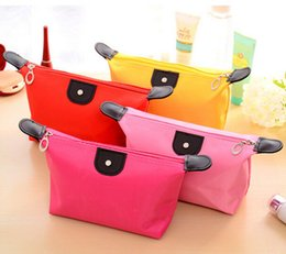 Wholesale dumplings shaped candy color cosmetic bag women containing wash bags hand holding makeup handbags for girls