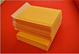 Compra Online Burbuja de papel kraft-La burbuja amarilla del bolso de papel de Kraft del sobre de la burbuja de Wholesale-10pcs los 11 * 15cm Kraft empaqueta el bolso del envío de Mailbags