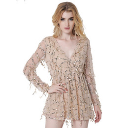 Europe and the United States women's new long sleeved 2017 V deep pleated skirt sexy dress female tassel sequins short skirts in summer.