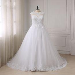 2017 Plus Size Wedding Dresses A-line Sheer Tulle Appliques Lace Bridal Gowns Bandage Lace Up Back Maxi Big Size Robes De Mariage
