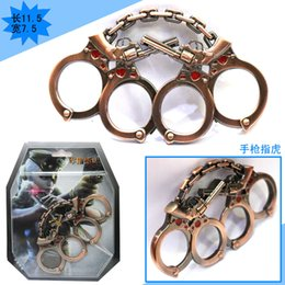 Wholesale Defensemen Cowboy Revolver Knuckle dusters Hand thorn High hardness Alloy Brass knuckles Copper color Self Defense toys Iron Boxing gloves