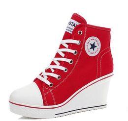 Descuento top zapatos altos zapatos del elevador La divisa libre 2015 del envío acuña las altas mujeres superiores de las zapatillas de deporte de la cuña de los zapatos de lona del alto talón del cordón de los altos zapatos ocasionales del deporte