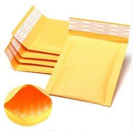 Burbuja de papel kraft en Línea-La envoltura al por mayor de los bolsos de la burbuja de Kraft del fabricante 100pcs / lot envolvió los bolsos de envío de papel 11X13cm + 4cm de los sobres que enviaban libremente