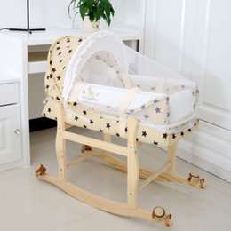 Wholesale High quality baby cradle basket with mosquito nets two way swing wooden wheeled the baby sleep basket of neonatal bed